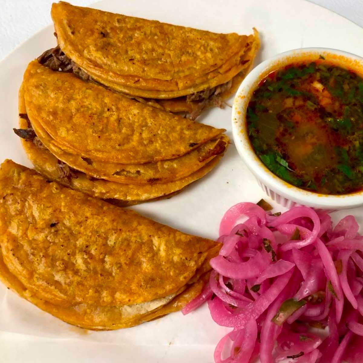 Los Famosos Tacos Planchados de Birria